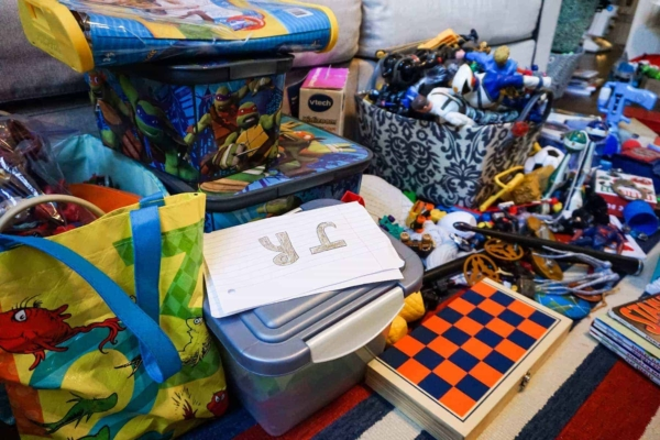 cleaning up a messy playroom