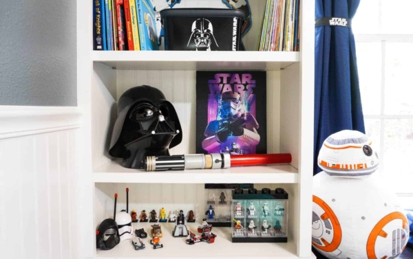 Bookshelf Decorated With Star Wars Toys, Decor and Canvas Art