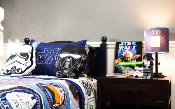 Star Wars Bedding & Nightstand Decorated With Star Wars Canvas Art & Lamp