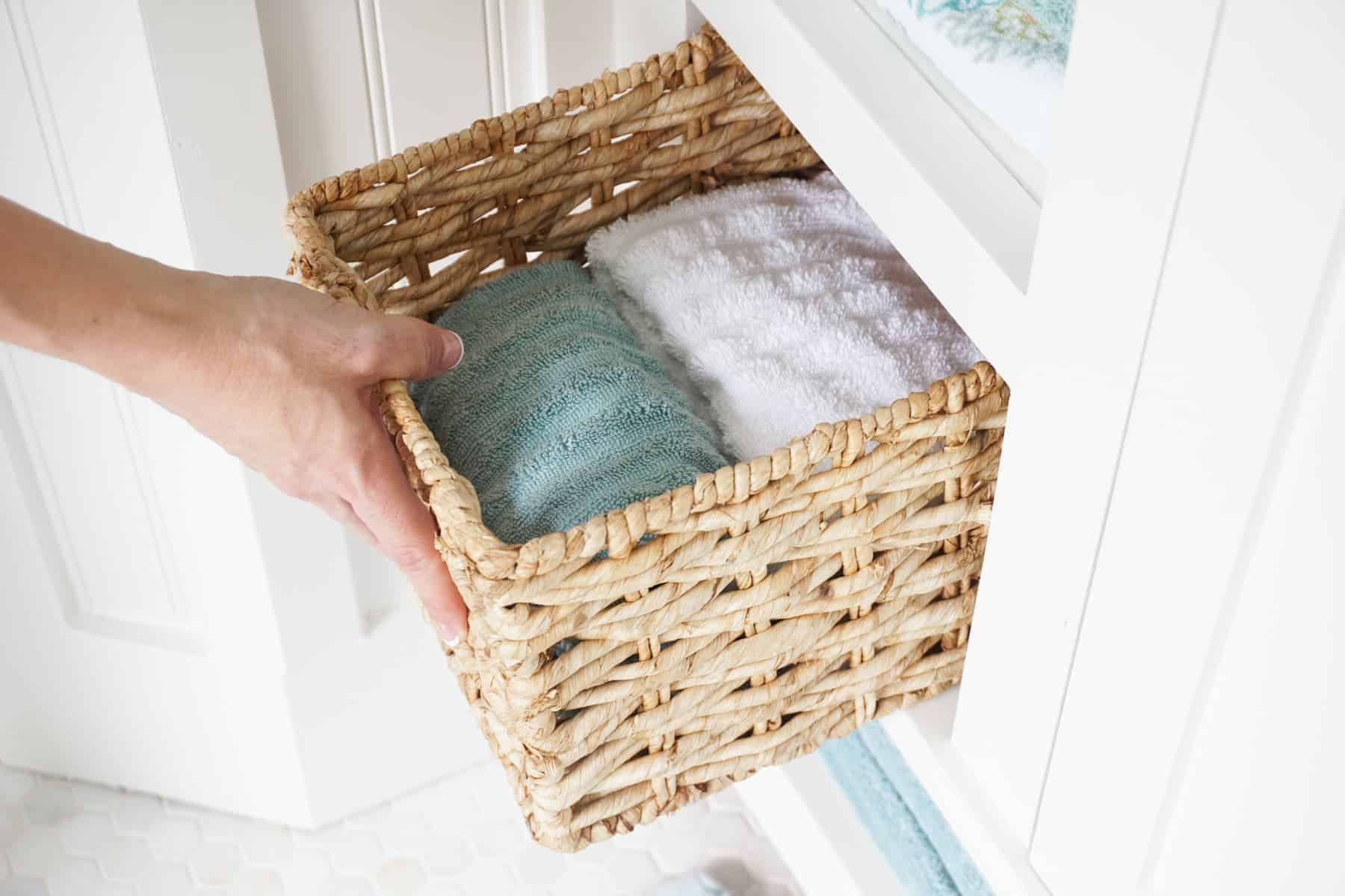 Store bath towels in baskets