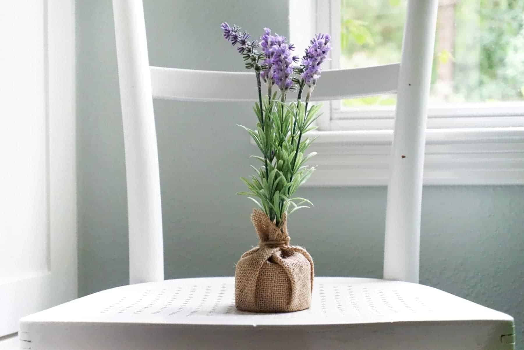 Lavender Flowers In A Burlap Sack Sitting On A Chair