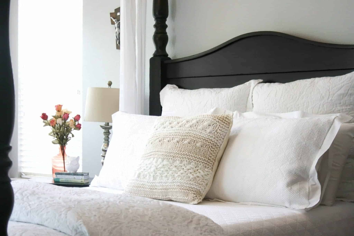 White bedding is the perfect backdrop for colorful throw pillows.