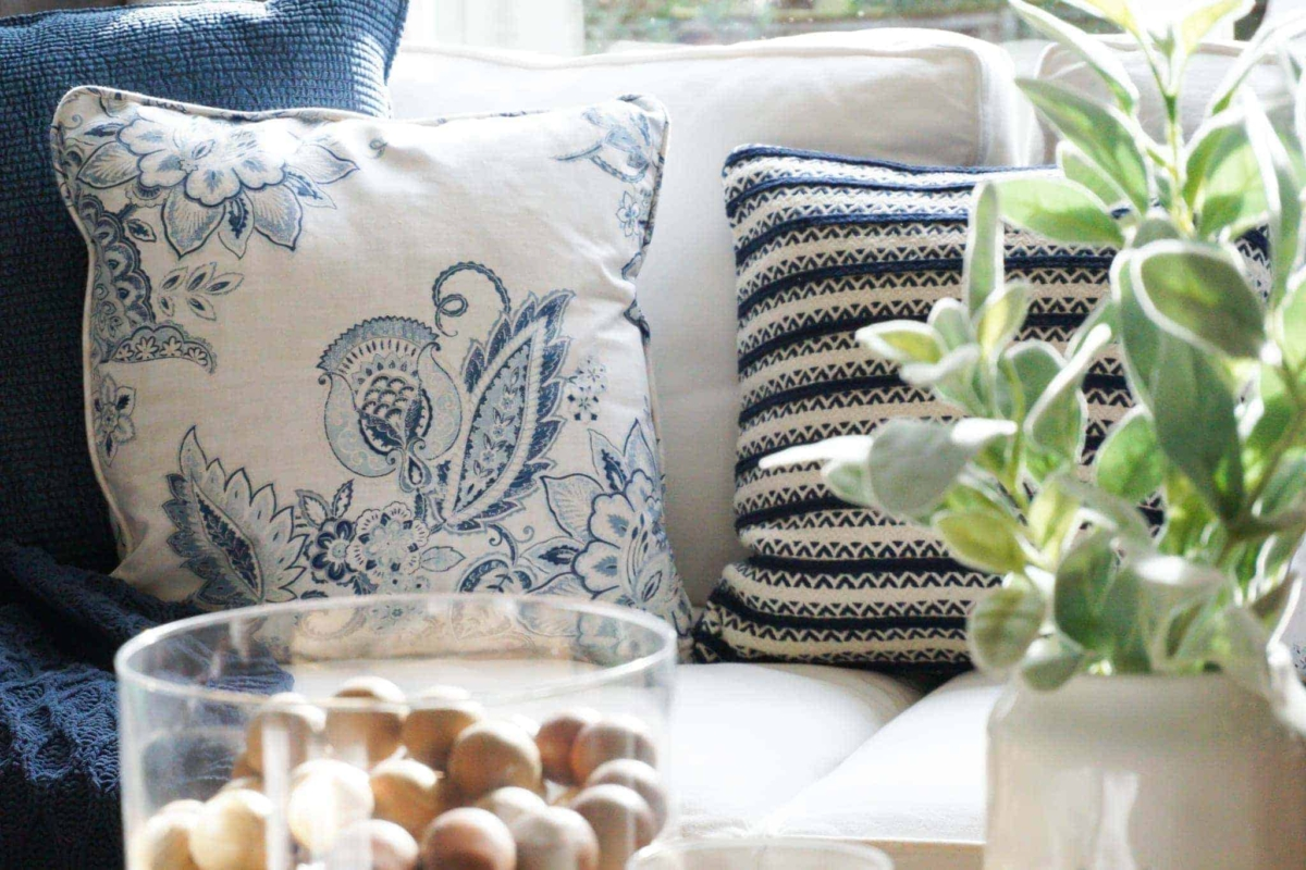 A white sofa is the perfect backdrop to color throw pillows and throw blankets.
