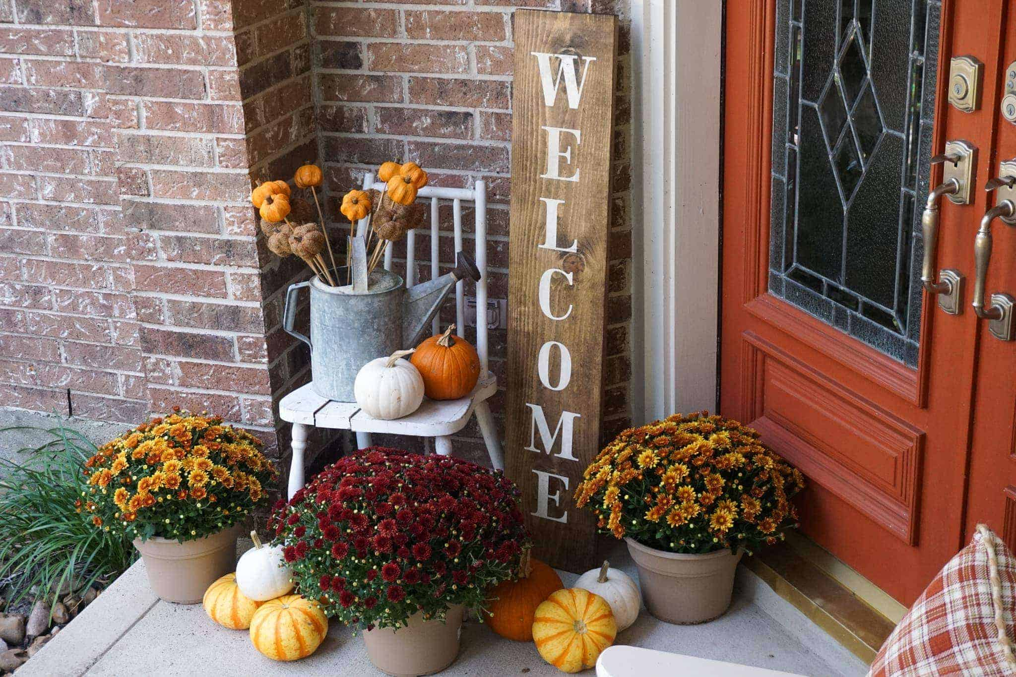 Decorating a front porch for fall.