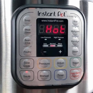 allowing the instant pot to warm up to saute onions for tomato soup