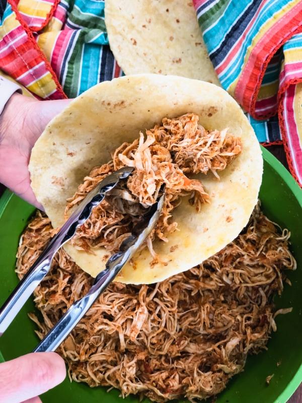 serving salsa chicken on a tortilla