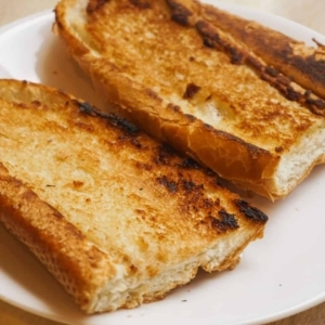 french bread slices that have been buttered and toasted
