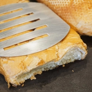 toasting bread on a skillet