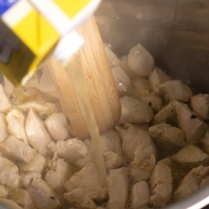 adding chicken stock to pressure cooker for tuscan chicken pasta