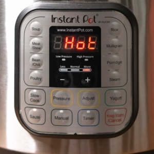 adjusting the instant pot saute heat to more for cooking tuscan chicken