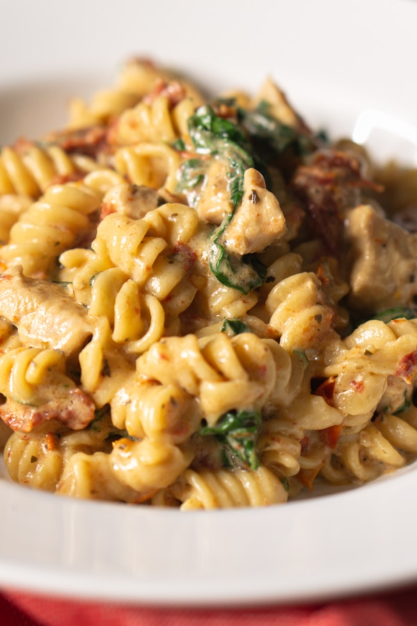 tuscan chicken pasta served on a plate