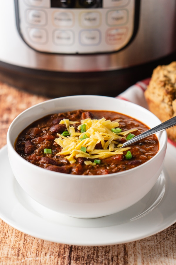a bowl of perfect homemade instant pot chili topped with shredded cheese