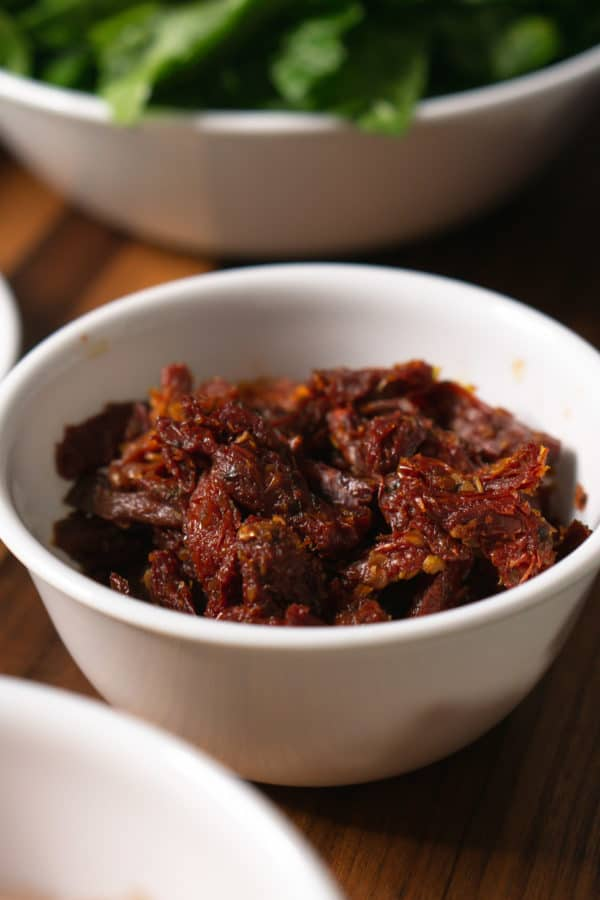 a small bowl of sun-dried tomatoes for making tuscan chicken pasta