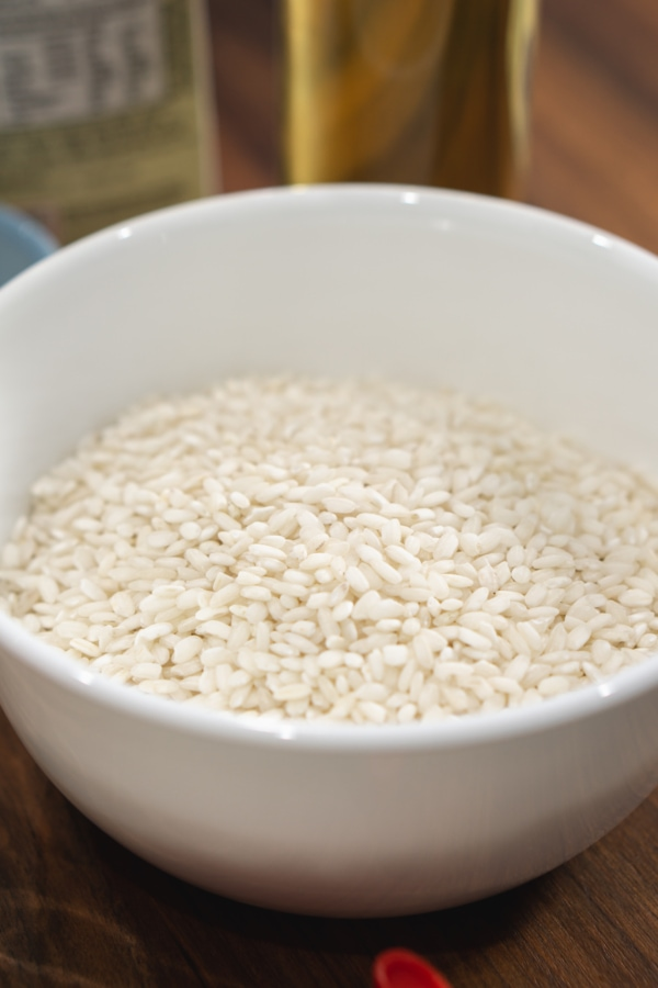 a bowl of arborio rice which is used for making risotto